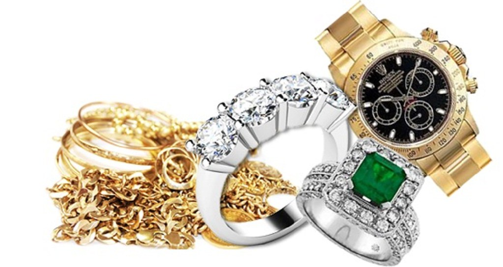 inherited jewelry with gold rings, gold chain, silver wedding band, silver engagement ring, emerald stone with diamonds ring and antique Rolex watch
