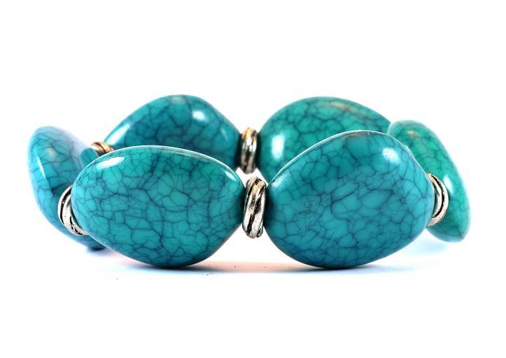 old used jewelry consigned to sell at a-1 auction Orlando, Florida turquoise bracelet with silver hardware