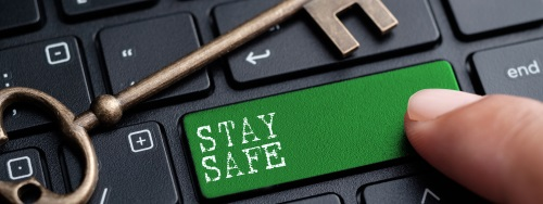 image of a computer keyboard in black with a green button that reads stay safe